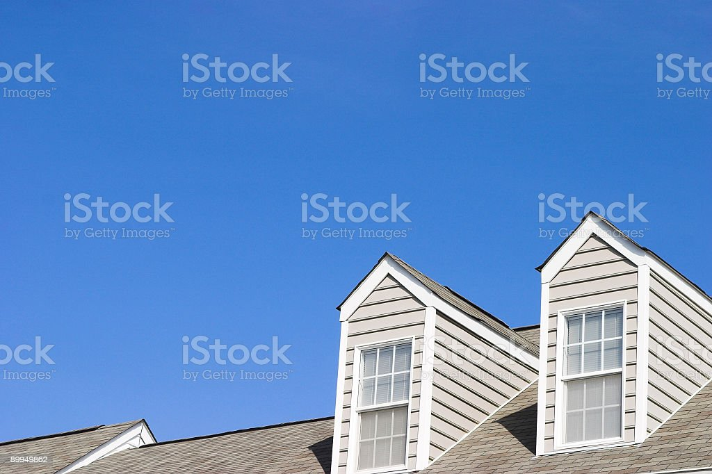 View of the top of the house with two windows royalty-free stock photo
