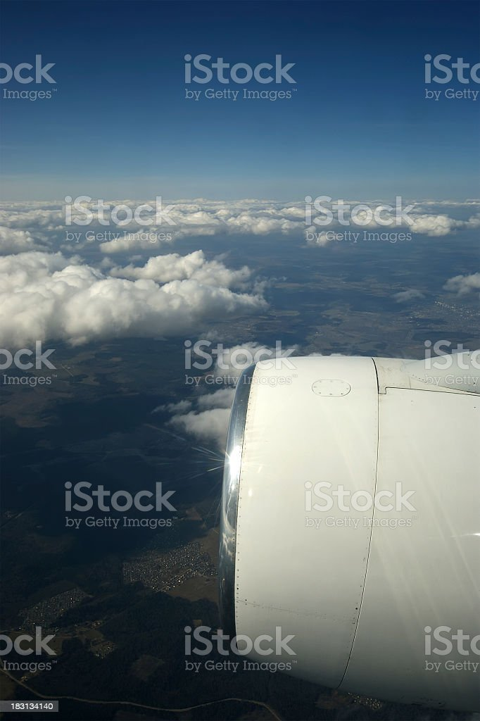 View of the turbine airplane, clouds and Earth stock photo