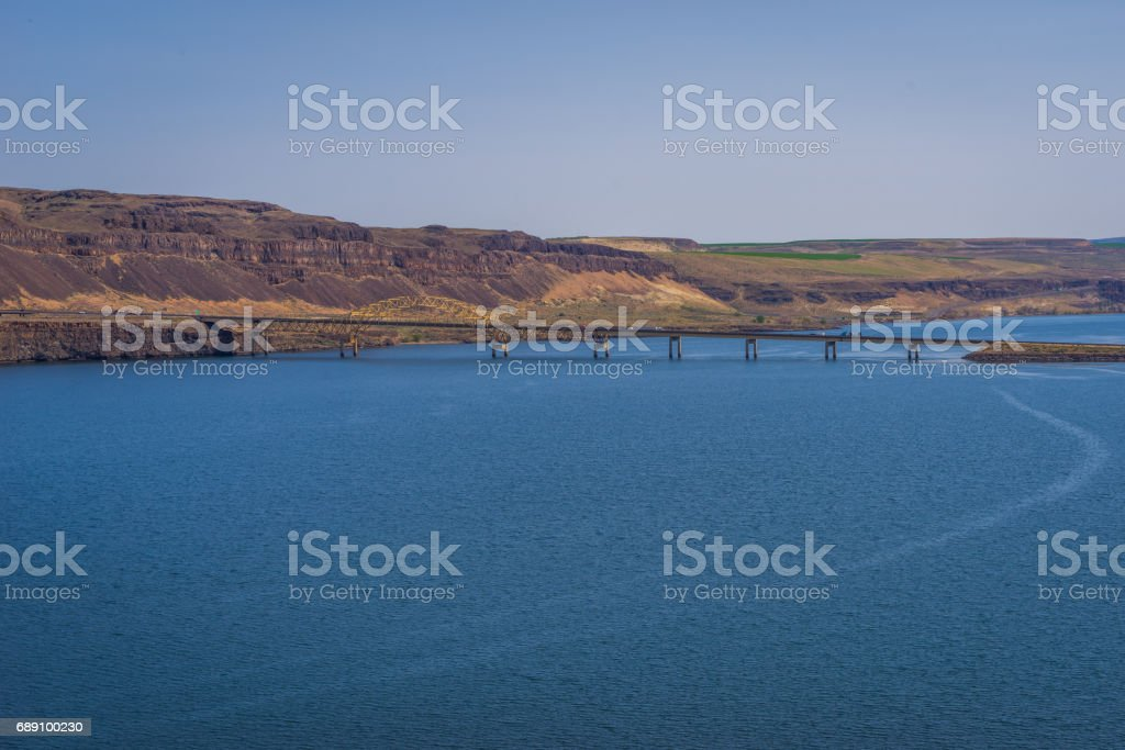View of the valley with the big river and the bridge. stock photo