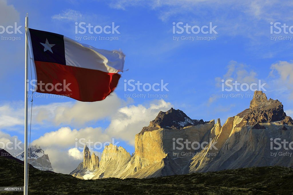 View of Torrer del Paine with Chilean flag stock photo