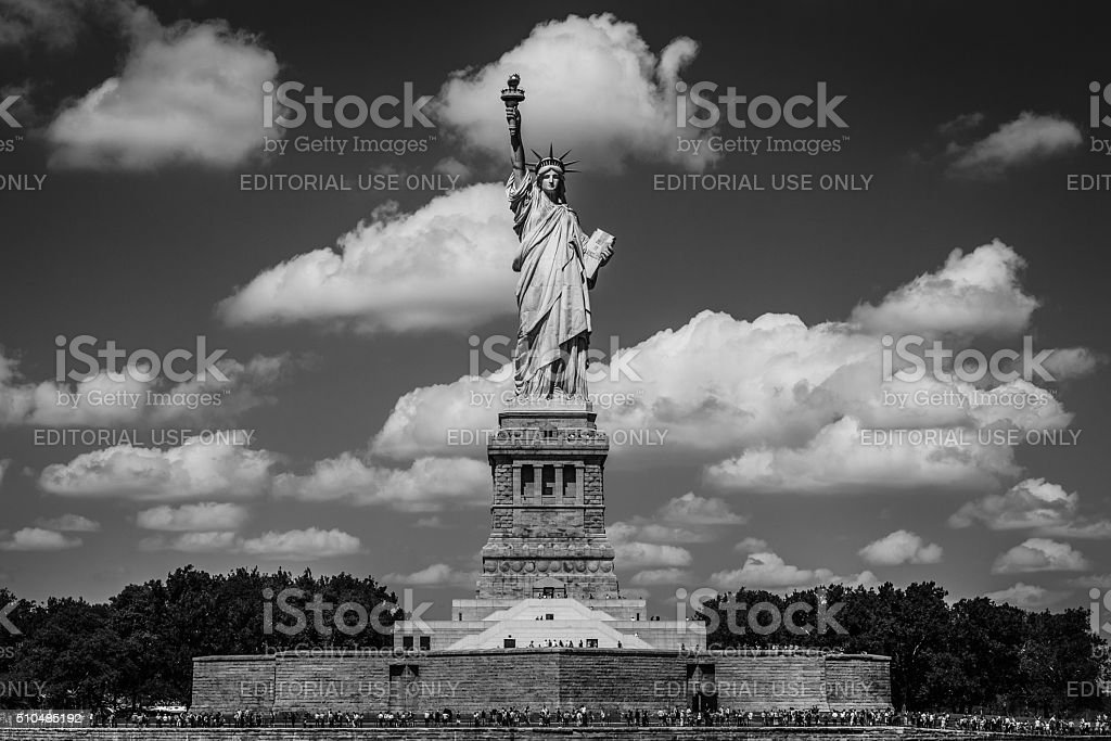 View of tourists around Statue of Liberty on summers day stock photo