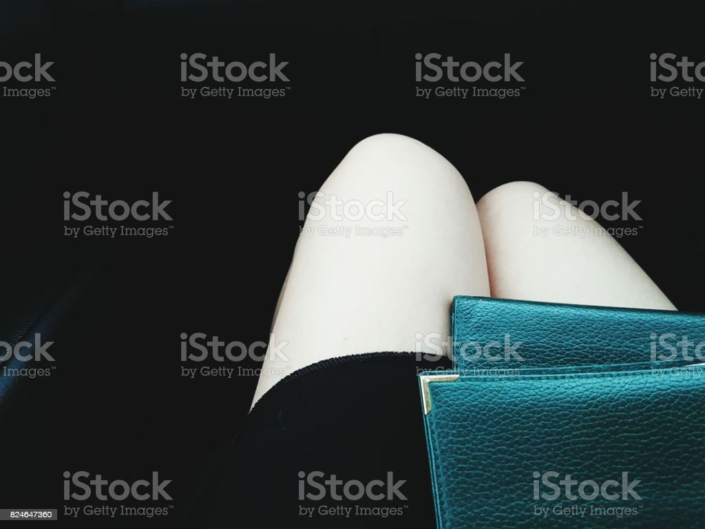 View of traveler/ tourist with passports on her laptop with black background stock photo