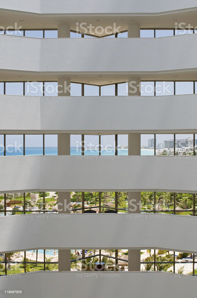 View of tropical resort through hotel windows royalty-free stock photo