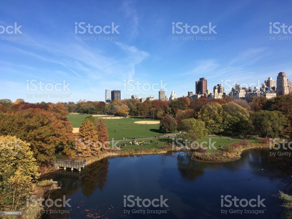 View of Turtle Pond and the Great Lawn in Central Park from Belvedere Castle on a clear summer day.  Blue skies a few clouds. View of Central Park New York. stock photo