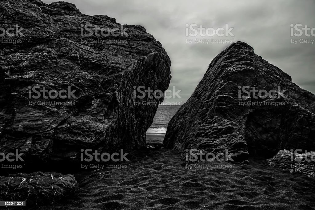 View of two large rocks with an opening in between and the sight of the ocean in Marin headlands near San Francisco. stock photo