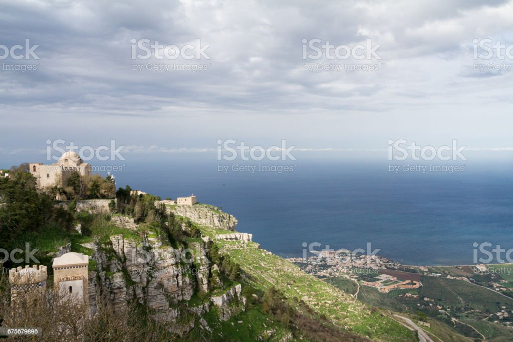 View of two old churches situated on Erice mountain, with the mediterranean sea in the background stock photo