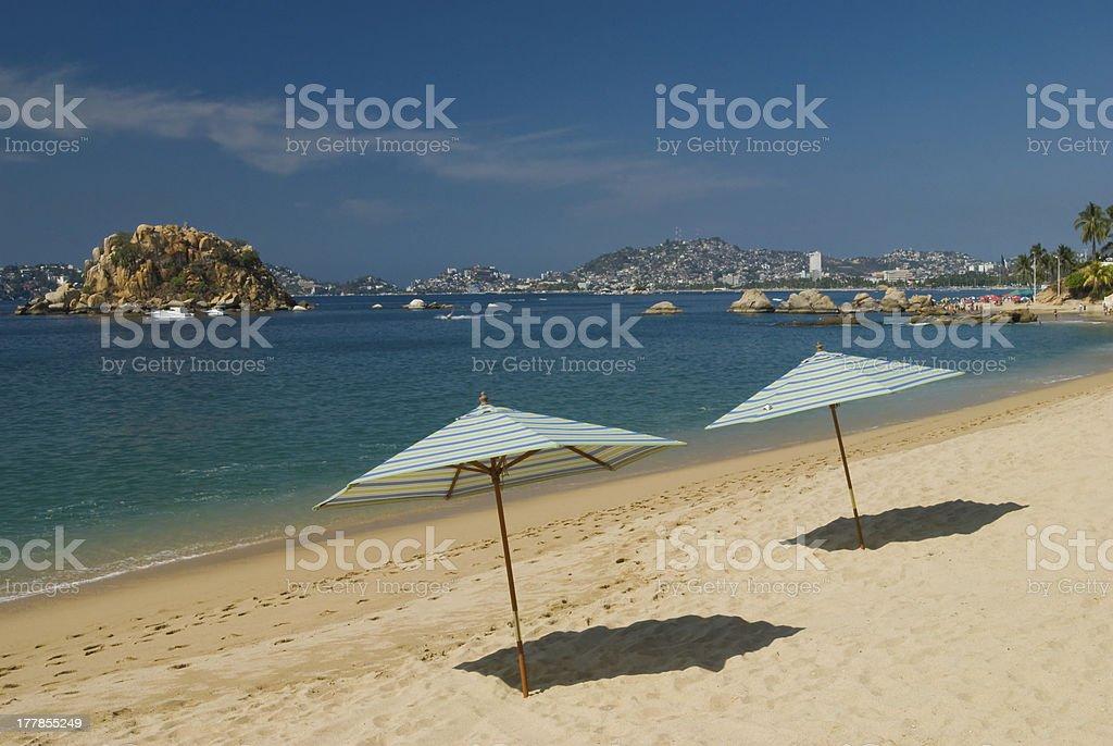 View of umbrellas on Acapulco beach stock photo