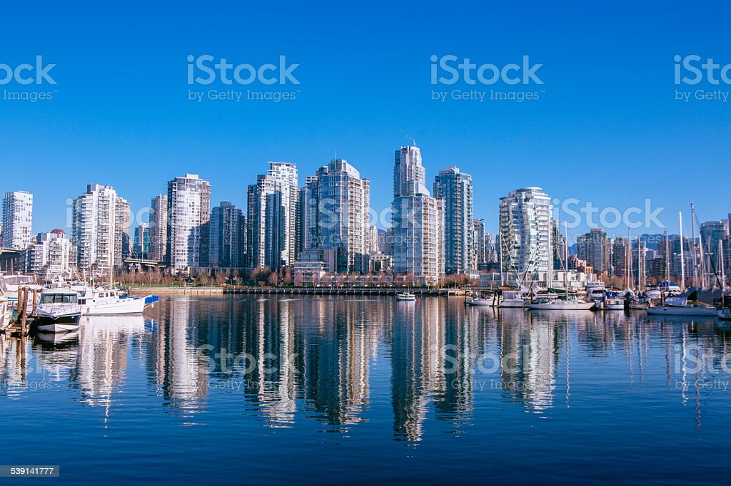 View of Vancouver's Glass Towers from False Creek Seawall stock photo