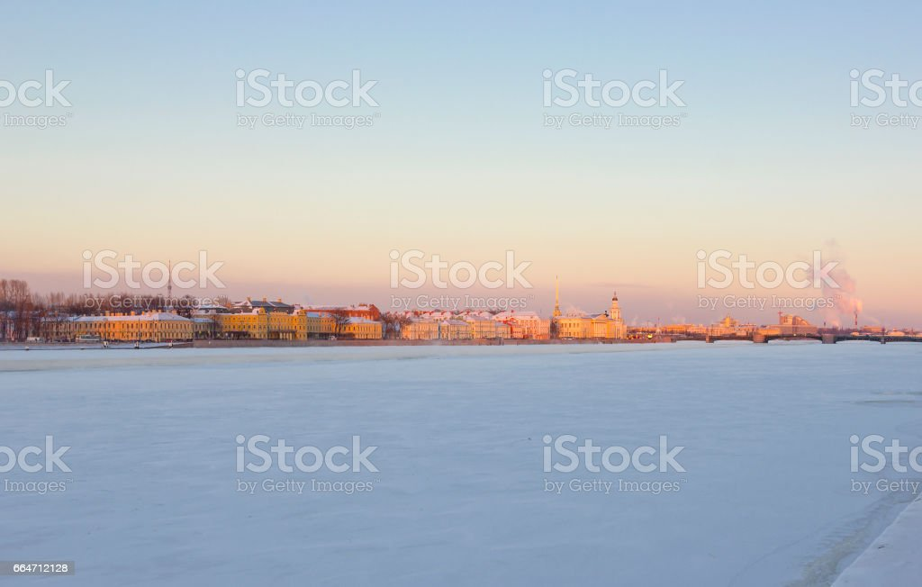 View of Vasilievsky Island with Kunstkamera, cathedral spire, Rostral Columns and bridge across Neva in Saint Petersburg, Russia stock photo