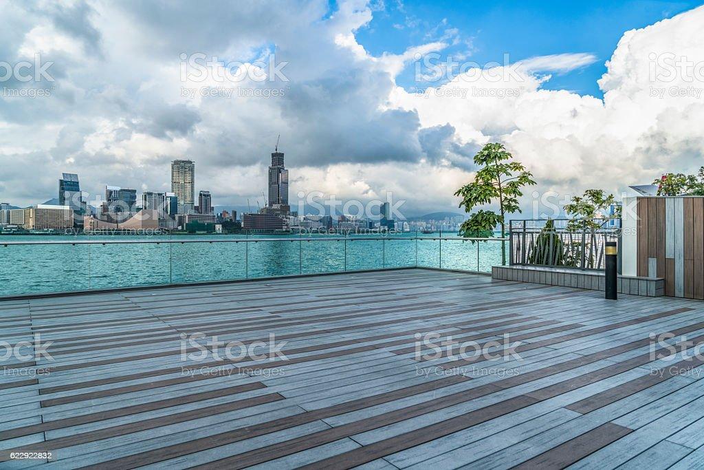 view of victoria harbor from empty floor stock photo