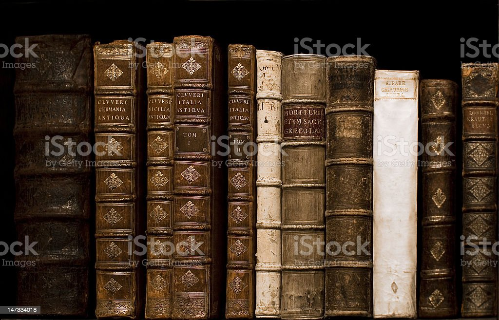 View of vintage books on shelf stock photo