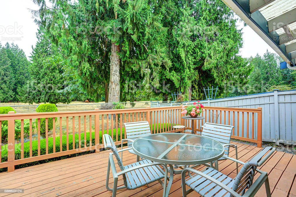 View of walkout deck with Patio furniture. House exterior in Tacoma....