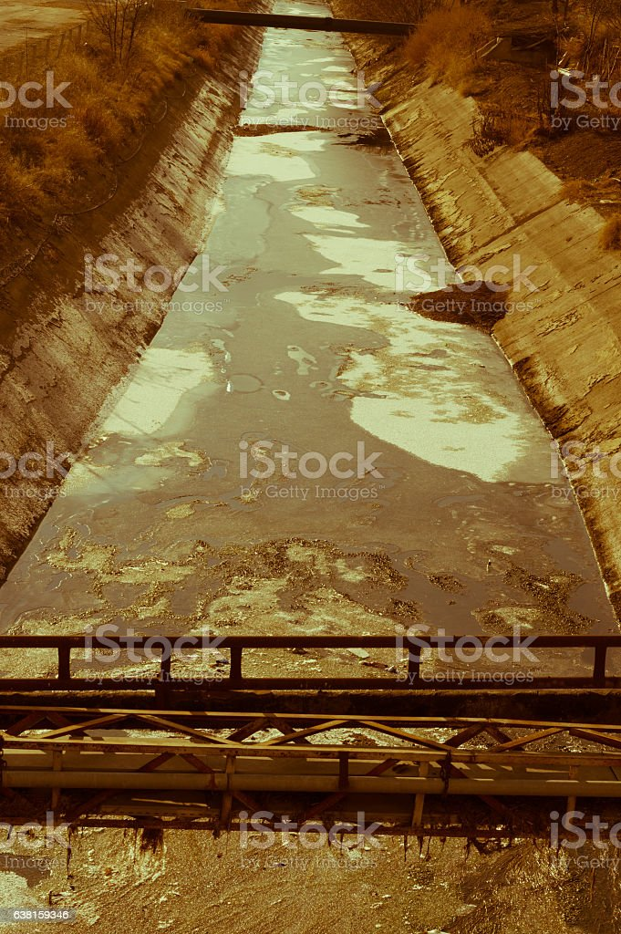 View of waste-water, pollution and garbage in a canal stock photo