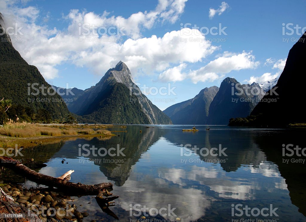 View of water and mountains in Milford Sound New Zealand stock photo