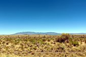 View of West Mesa, Volcanoes, and Sandia Mountains in Albuquerque.