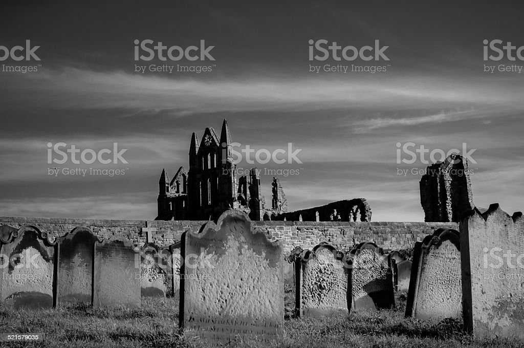 View of Whitby Abbey and cemetery during the night stock photo