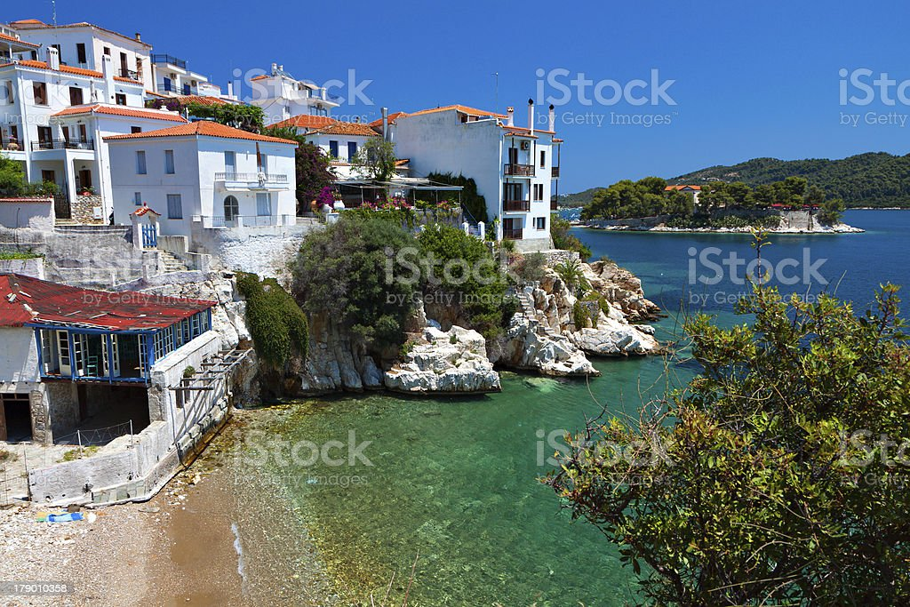 View of white houses by ocean in Skiathos Island in Greece stock photo