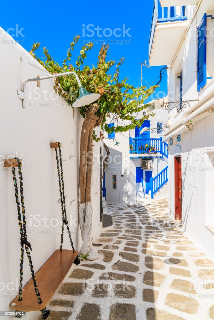 A view of whitewashed cycladic street in beautiful Mykonos town, Cyclades islands, Greece stock photo