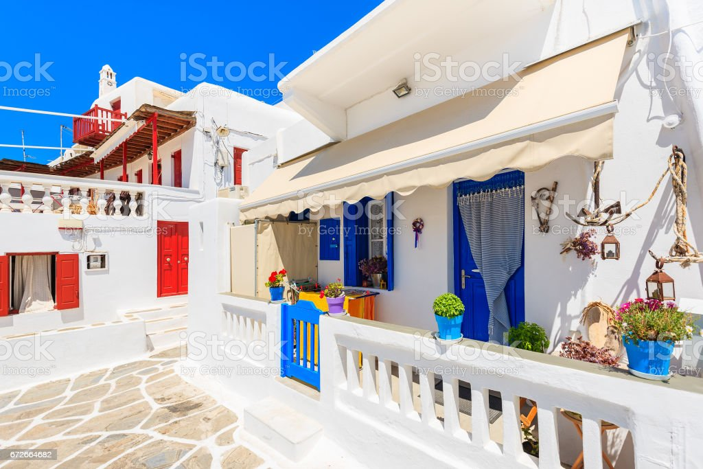 A view of whitewashed street with typical Greek houses in beautiful Mykonos town, Cyclades islands, Greece stock photo
