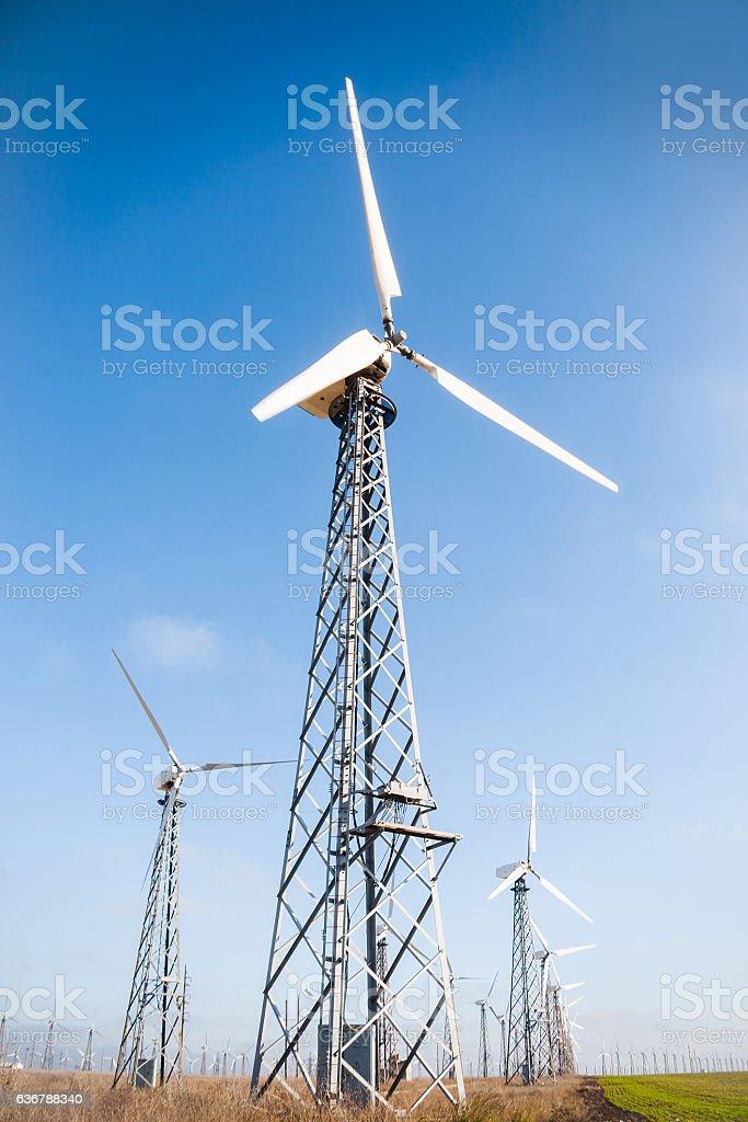 View of wind turbine on blue sky background stock photo