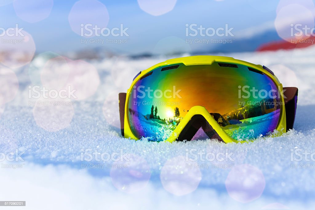 View of yellow ski mask on white icy snow stock photo