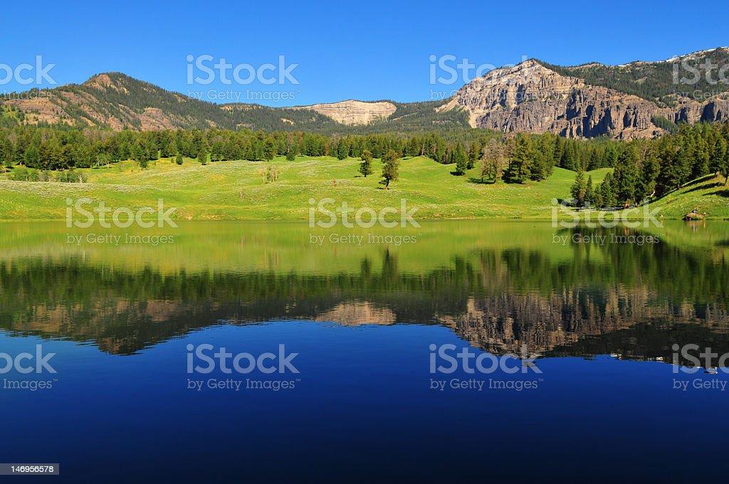 A view of Yellowstone Lake reflecting the scenery stock photo