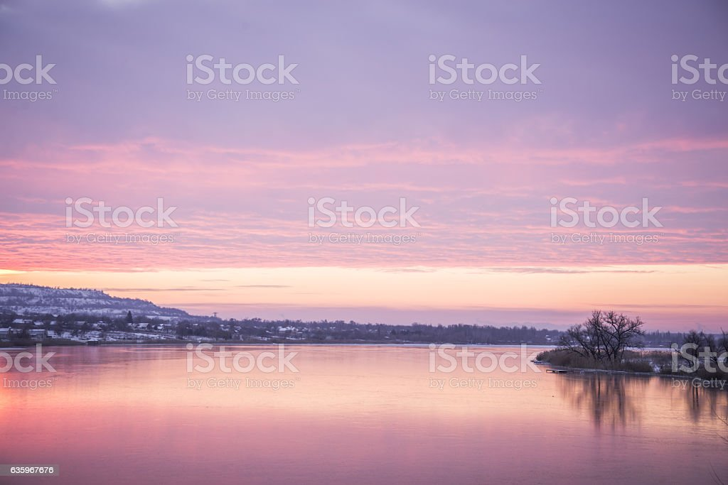 view on a lake with sunrice stock photo