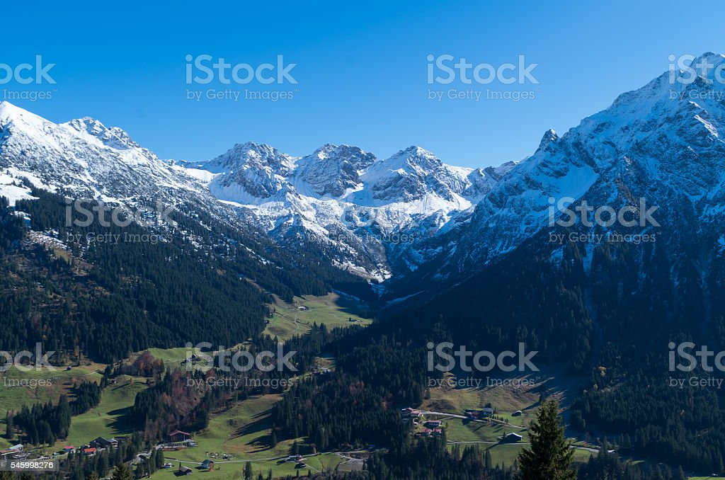 View on an alpine valley in spring, Kleinwalsertal, Austria stock photo