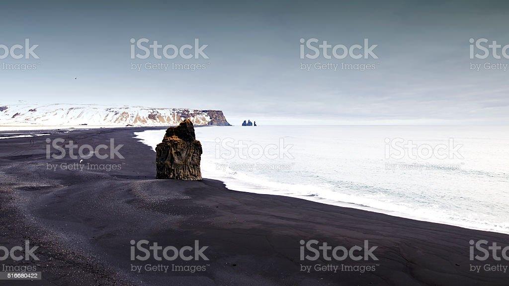 View on black sand Reynisfjara beach and volcanic rocks,Iceland stock photo