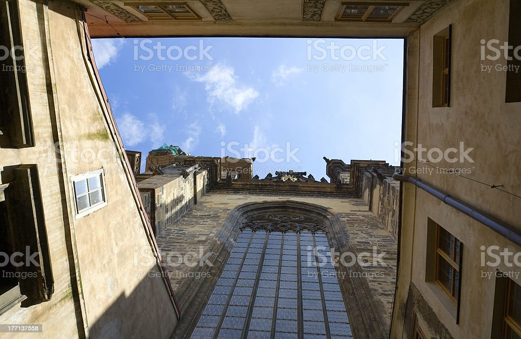 View on blue cloudy sky from church patio in Prague royalty-free stock photo