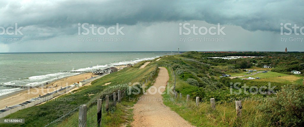 View on dutch seadike with approaching thunderstorm stock photo