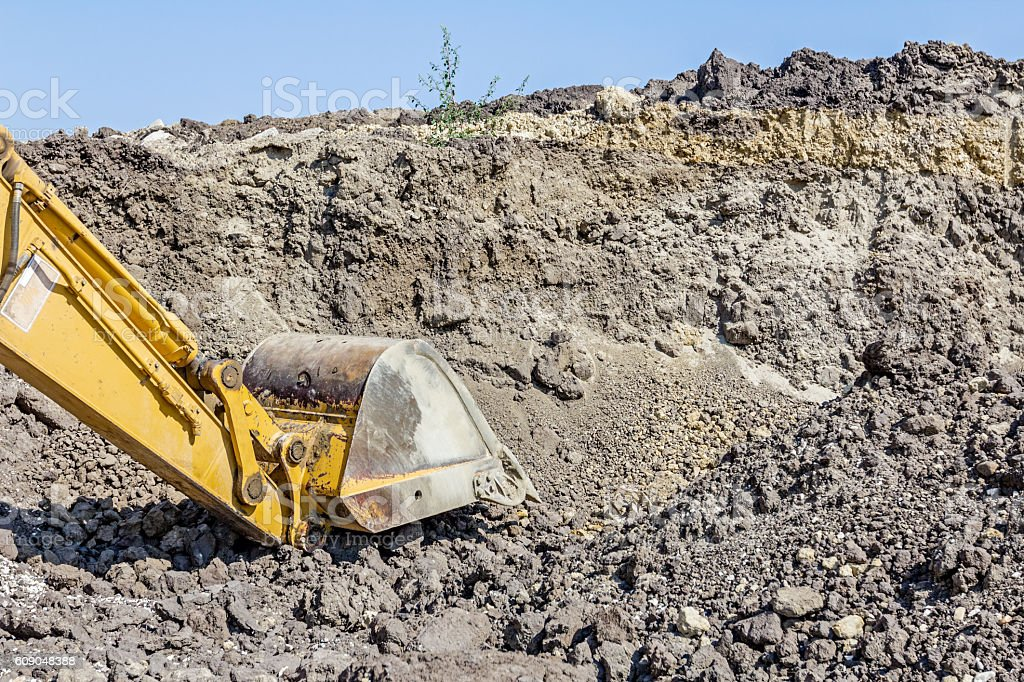 View on excavator who is working, caterpillar at construction si stock photo