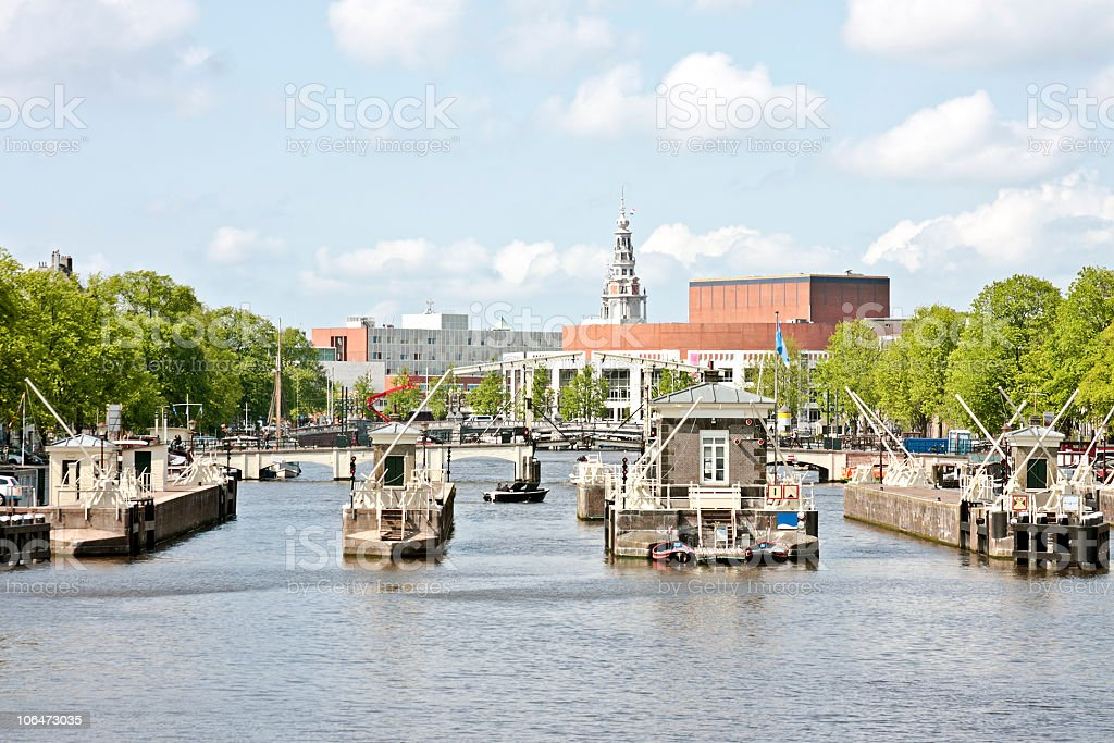 View on floodgates in the river Amstel  Amsterdam Netherlands royalty-free stock photo