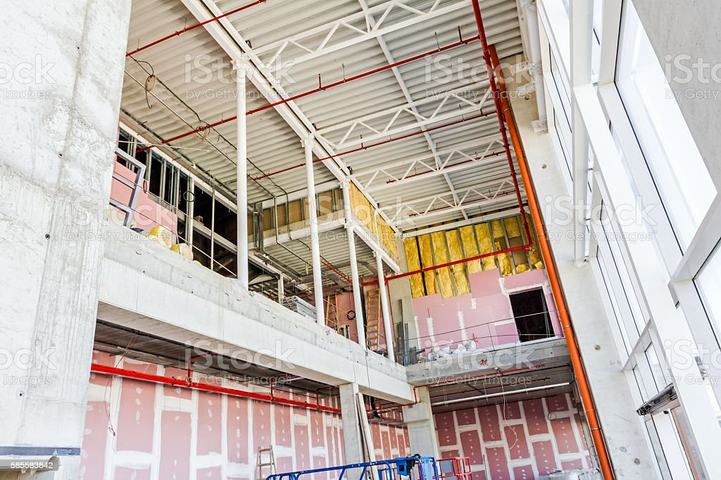 View on indoor construction site of unfinished modern large show stock photo