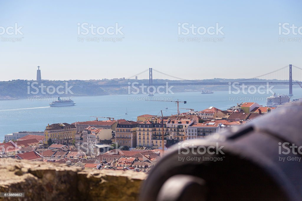view on Lisbon with old metal cannon trunk stock photo