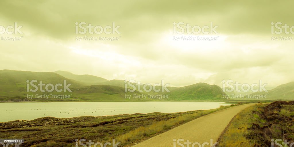 View on remote street in fjord landscape in Scotland stock photo
