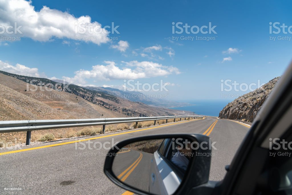 View on road of Crete island from driving car stock photo