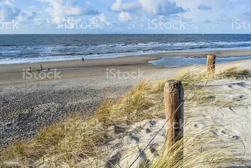 View on the beach from the sand dunes stock photo