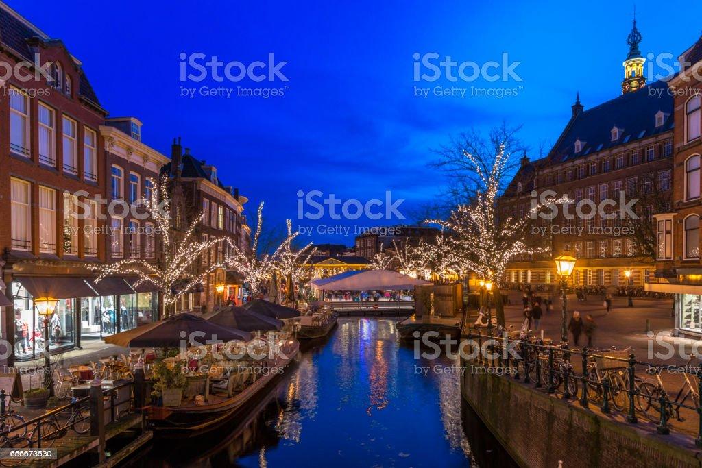 View on the Koorn bridge, people enjoying  Christmas Market in Leiden, the Netherlands stock photo