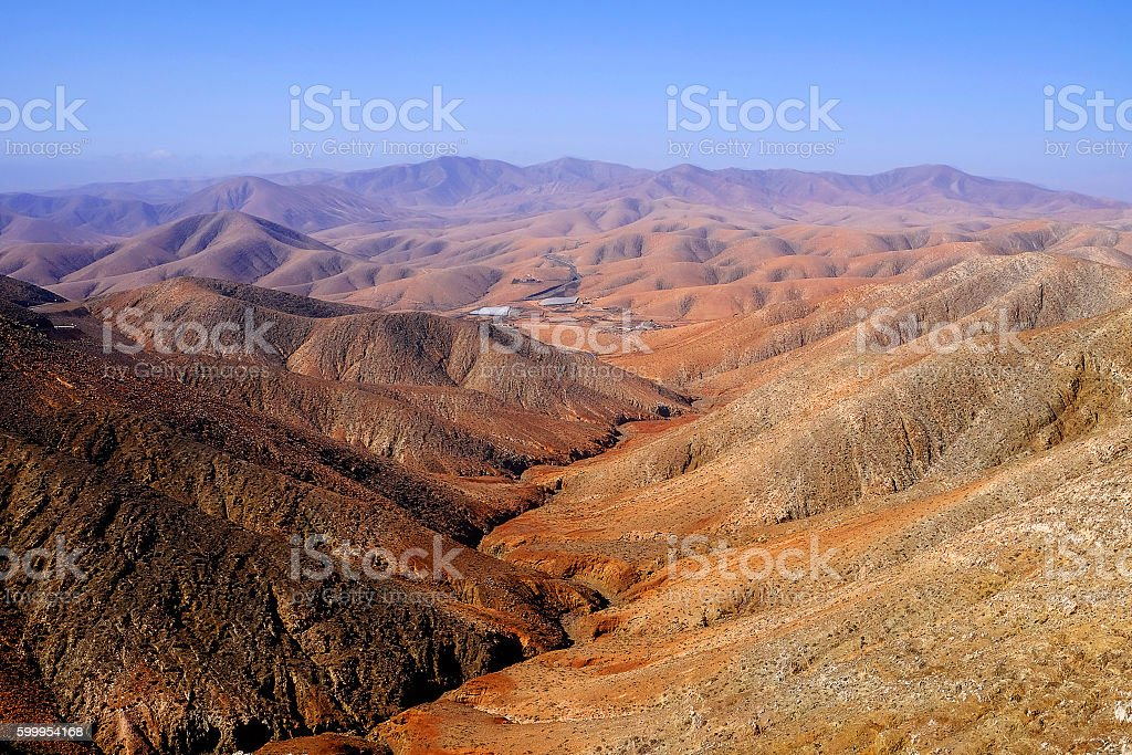View on the mountains of an unusual red-orange color. stock photo