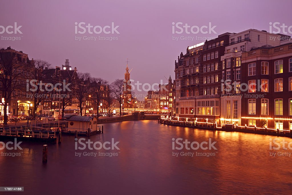 View on the Munt tower in Amsterdam Netherlands at twilight stock photo
