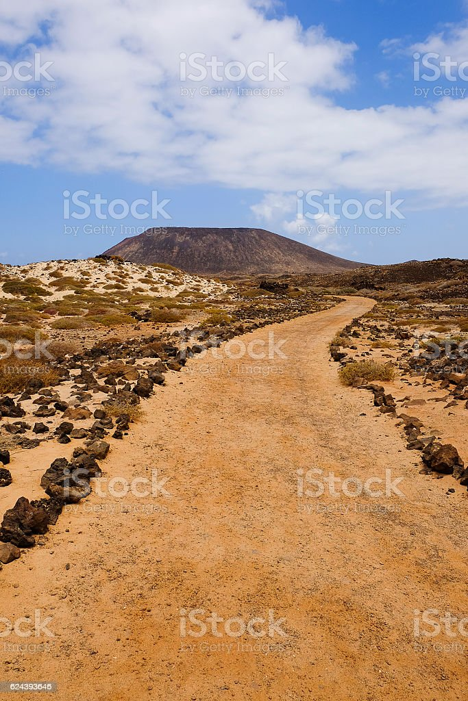 View on the path and mountain on the island Lobos. stock photo