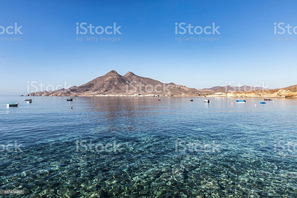 View on transparent water with fishboats stock photo
