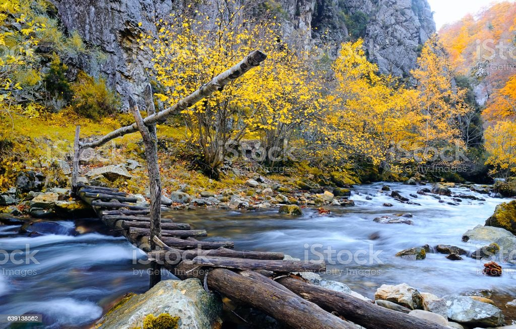 View on wooden bridge over mountain river stock photo