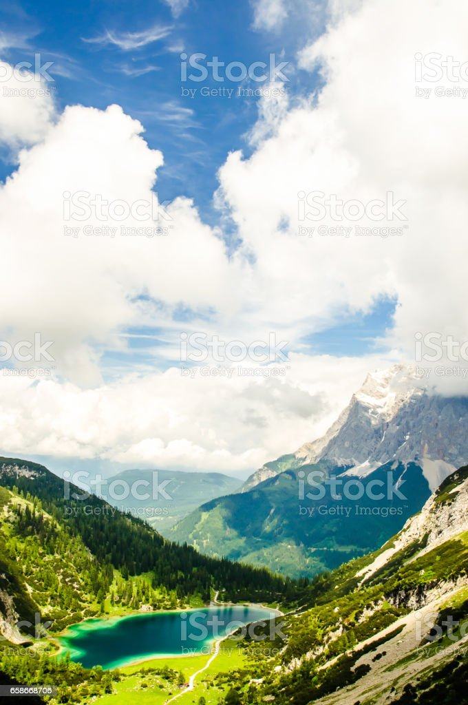 View on Zugspitze mountain from lake Seeben in Austria stock photo
