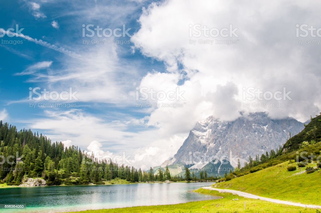 view on Zugspitze mountain from Seeben lake stock photo