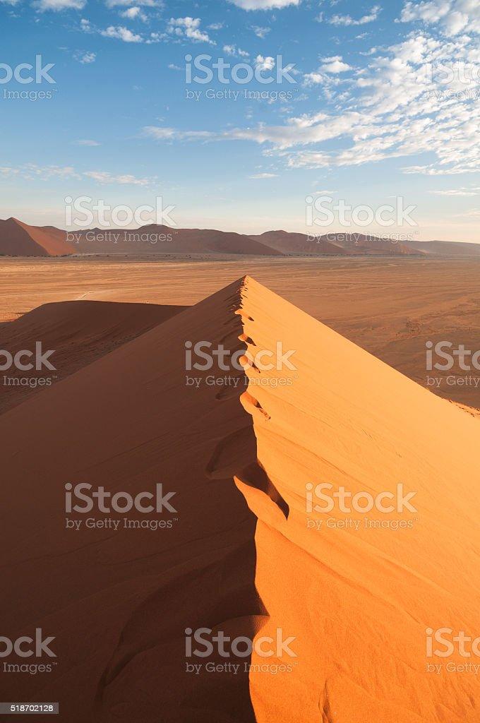View over beautiful Namib desert sand dune with footprints stock photo