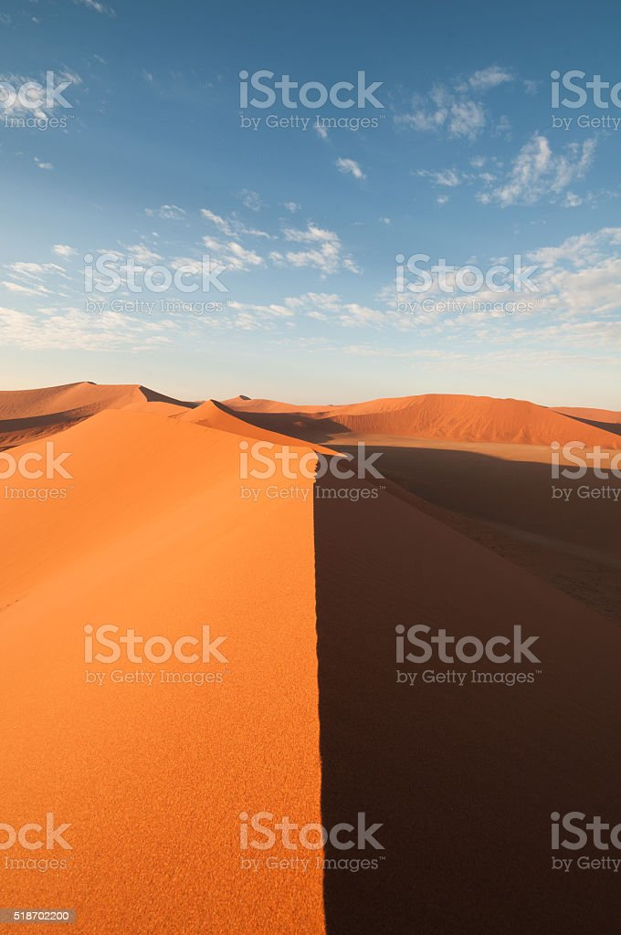 View over beautiful Namib desert sand dune without footprints stock photo