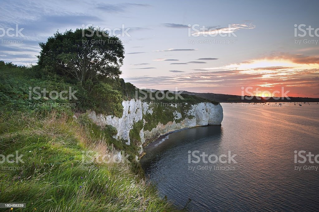 View over cliffs at sunset with yachts in bay royalty-free stock photo