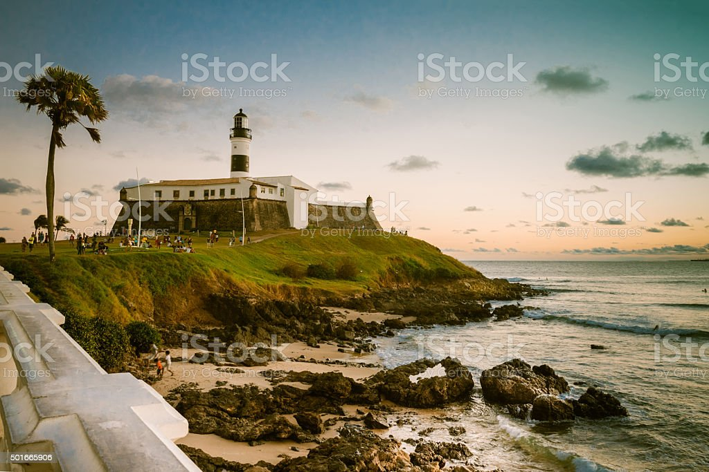 view over coast with lighthouse Farol da Barra in Salvador stock photo